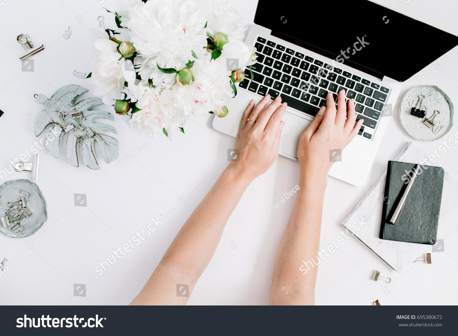 flat workspace home office. flat lay home office desk women workspace with female hands laptop white peony n