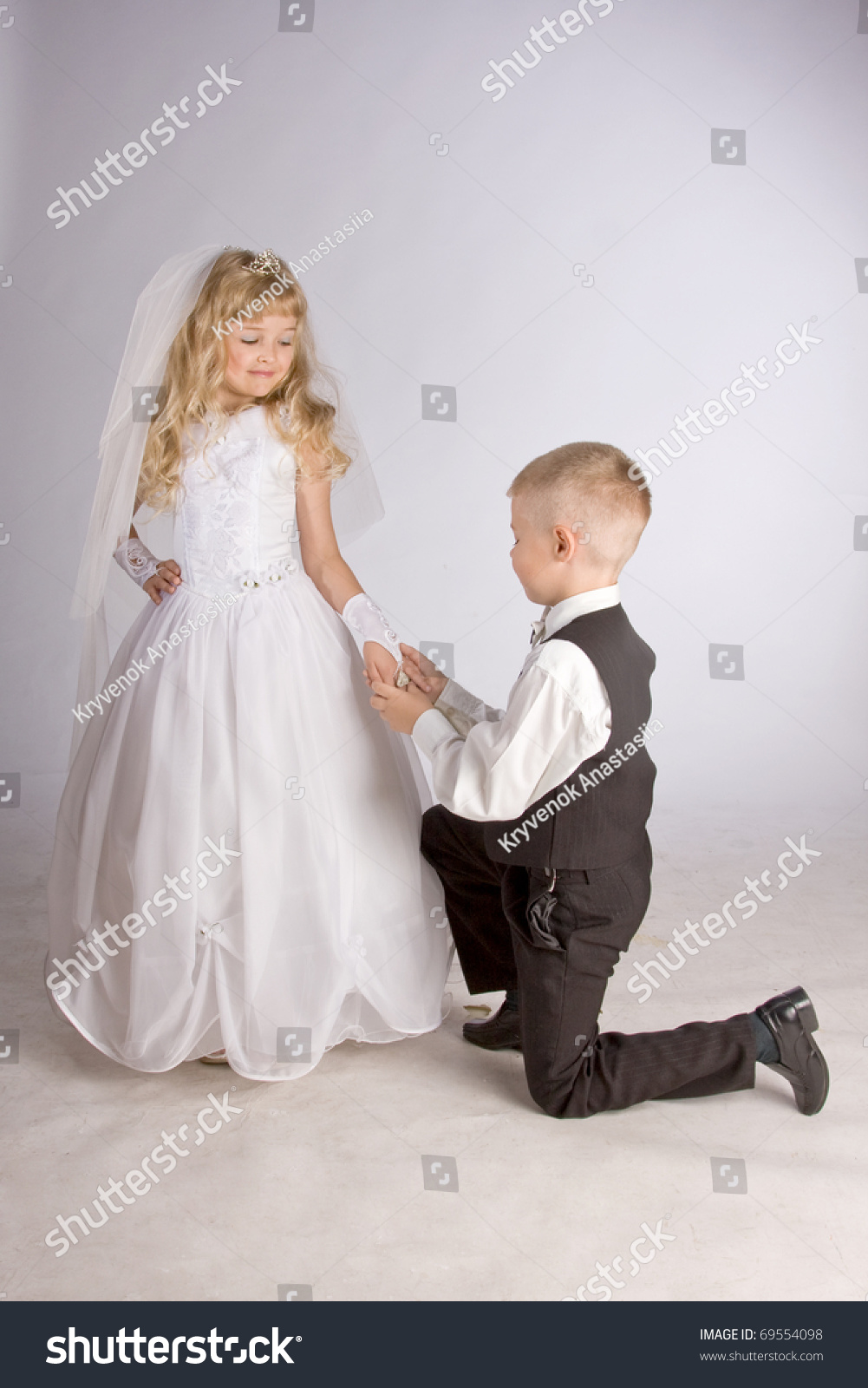this little bride groom are Just look at this little beauty she was a very shy little bride, but very cute the dress she is wearing was made for me when i was her age look how lovely she looks.