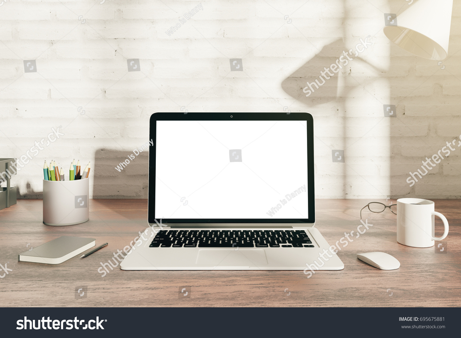 Plain wood table with hipster brick wall background stock photo - Front View Of Wooden Hipster Office Desk Top With Blank White Laptop Display Coffee Cup