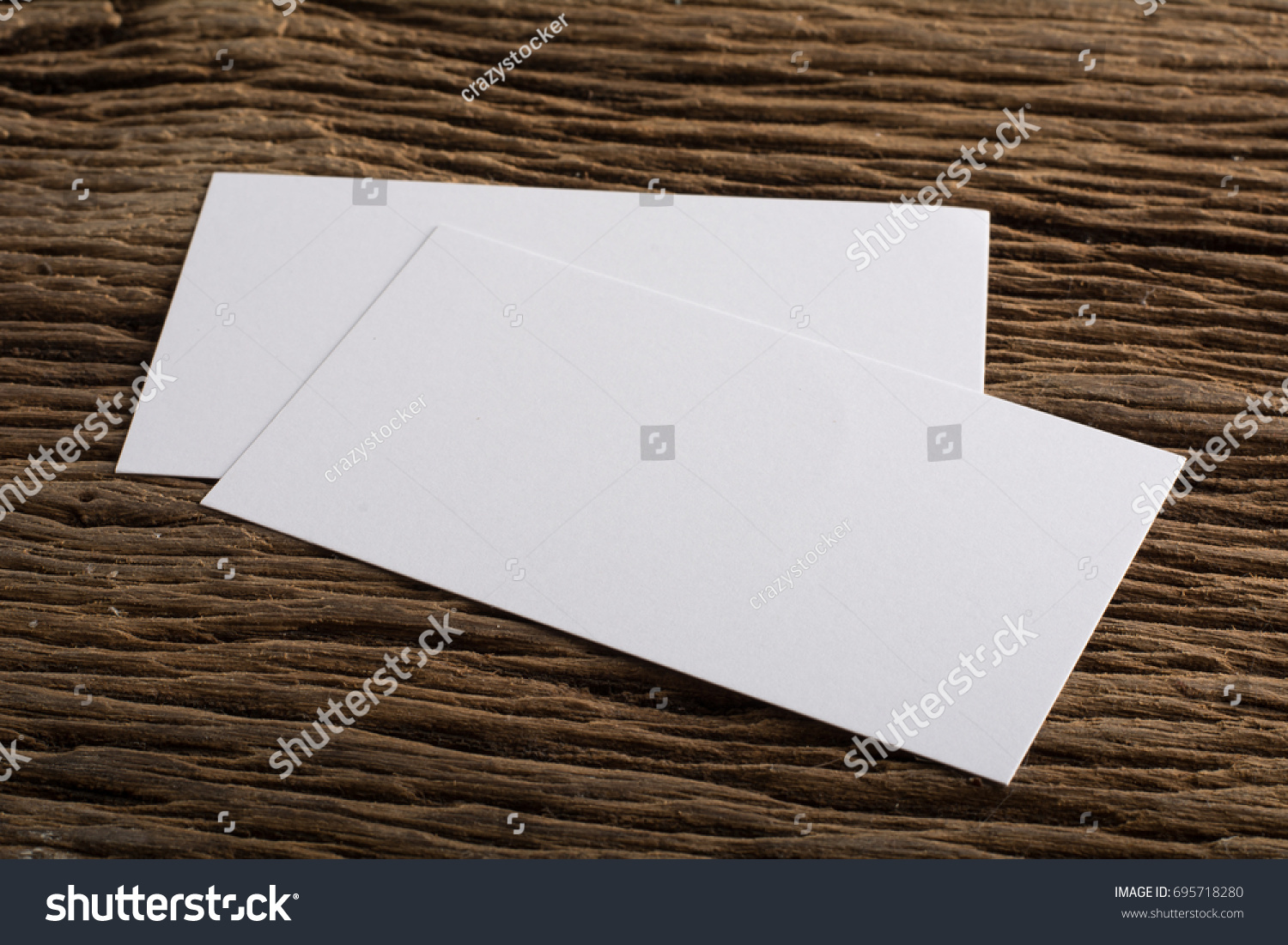 Blank white business card presentation corporate stock photo blank white business card presentation of corporate identity on wood background magicingreecefo Image collections