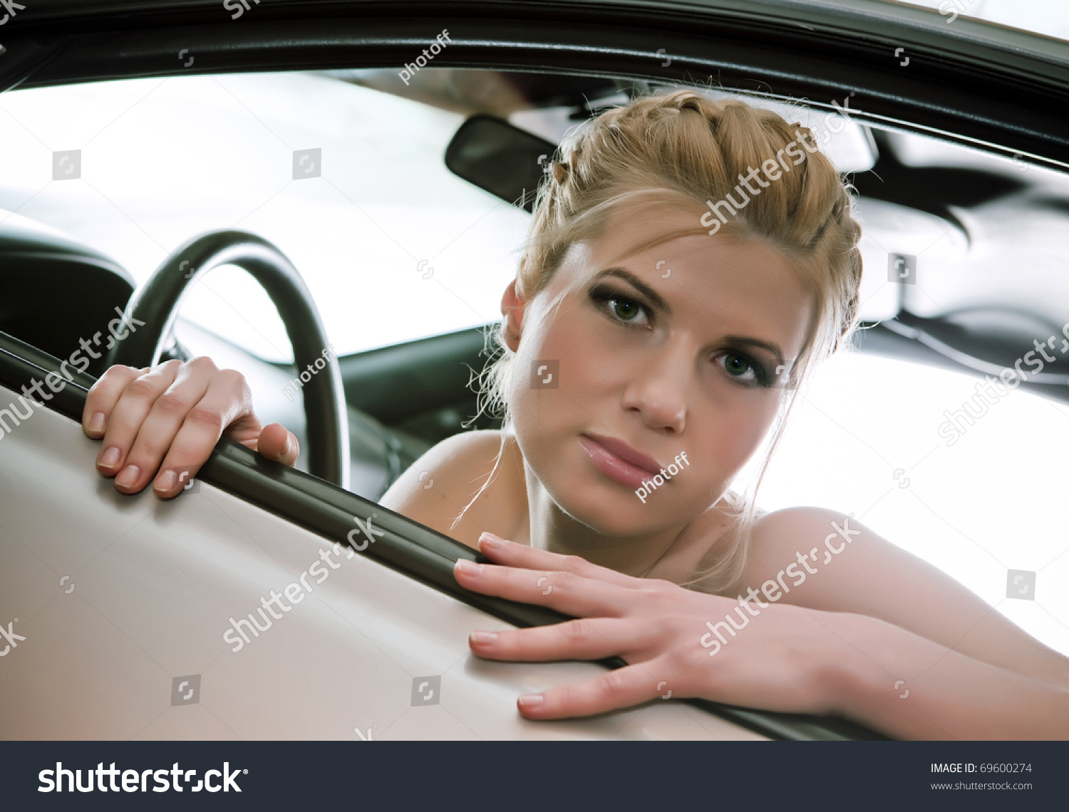 Young sexual blonde in the car