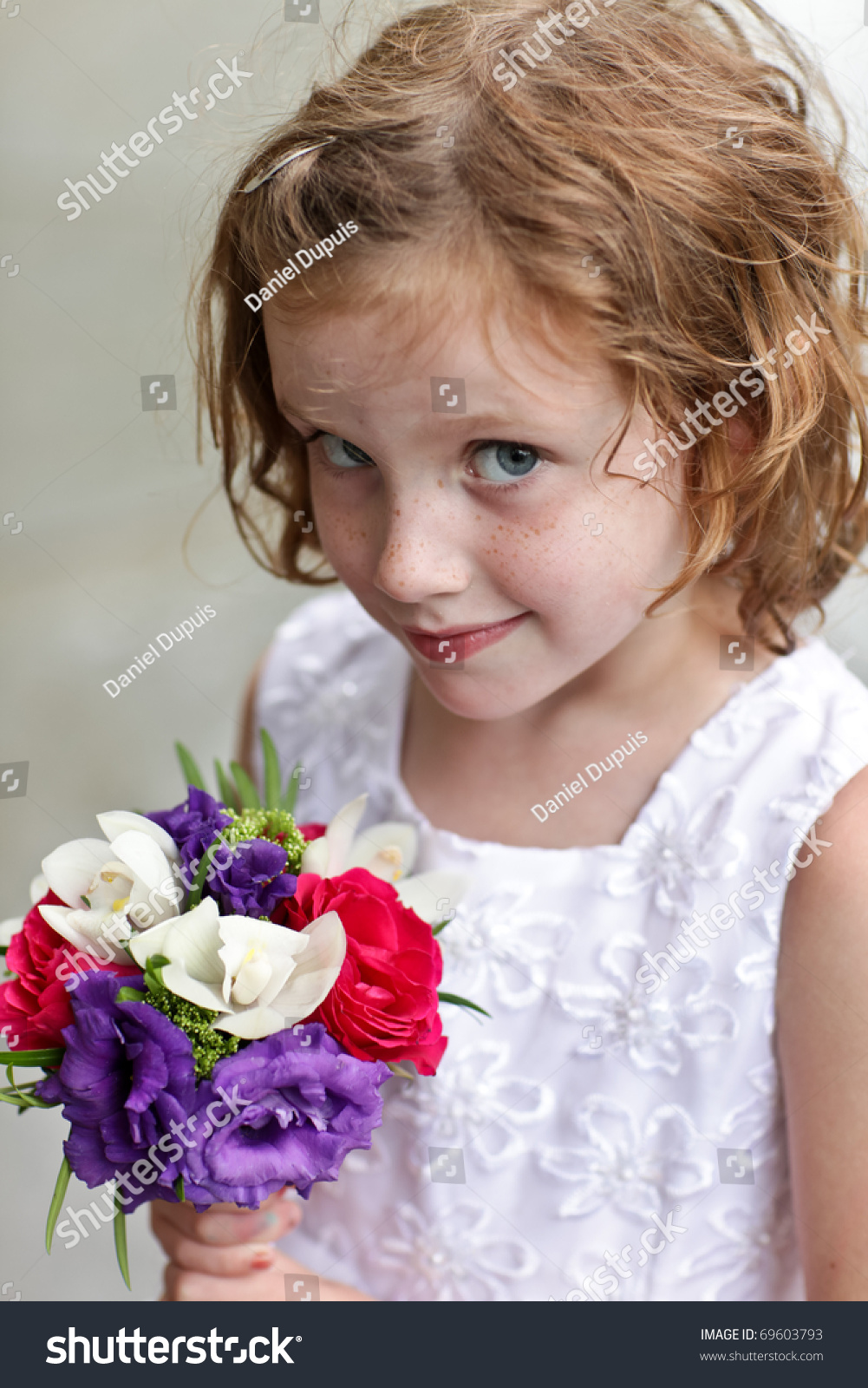Cute flower girl holding small bouquet stock photo edit now cute flower girl holding a small bouquet of flowers izmirmasajfo