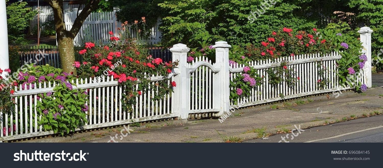 White picket fence flowers stock photo edit now 696084145 white picket fence with flowers mightylinksfo