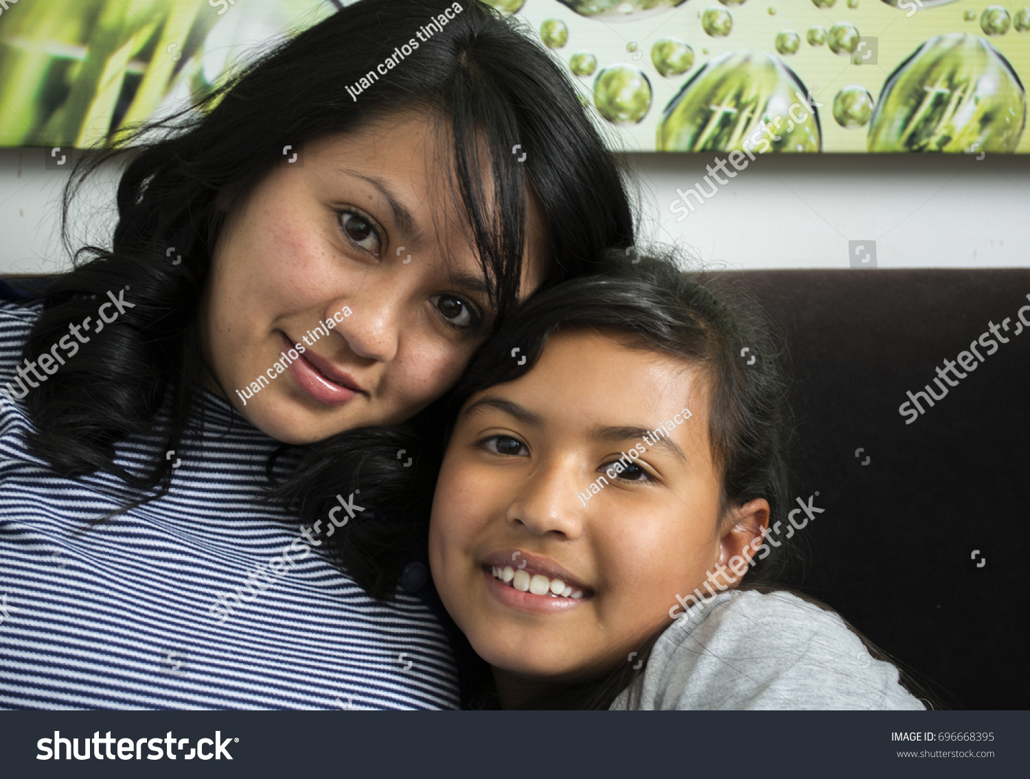 Young mother with her daughter.