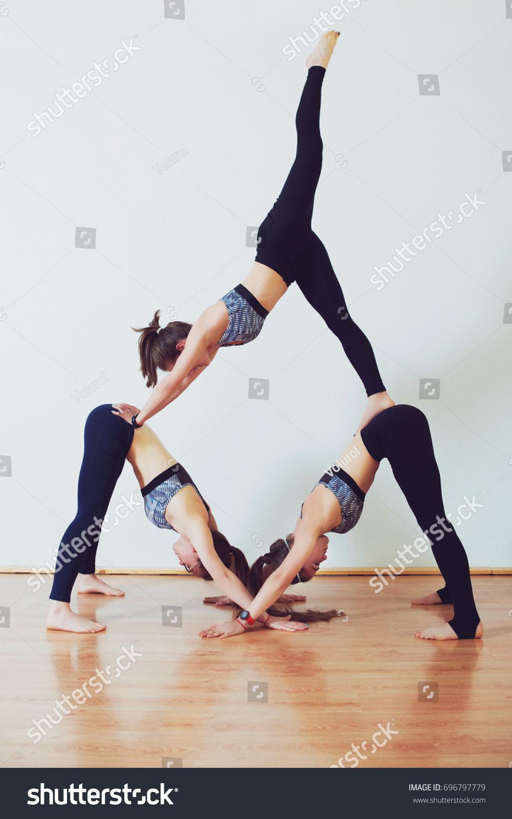 Three Young Women Practicing Acro Yoga Stock Photo Edit Now 696797779