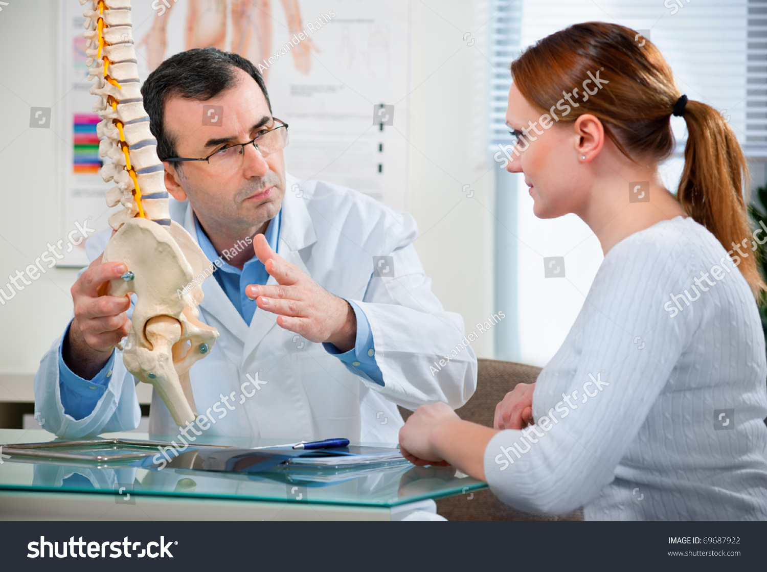 Physical Therapist Shows The Problem Areas On The Model Of ...