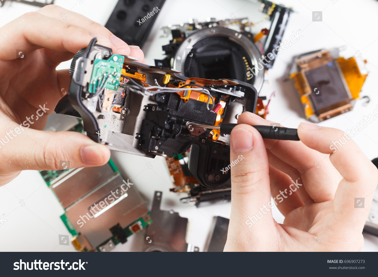 Close Up Hands Of A Service Worker Repairing Digital Camera Soldering Circuit Board In Electronics Factory And Sservice Concept Ez Canvas