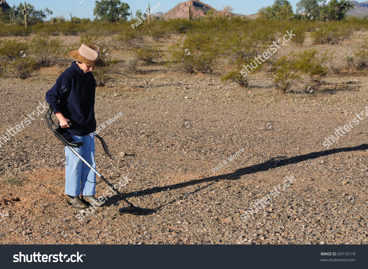 Jew Detector: Young Boy Hunting For Treasure With A Metal Detector Stock