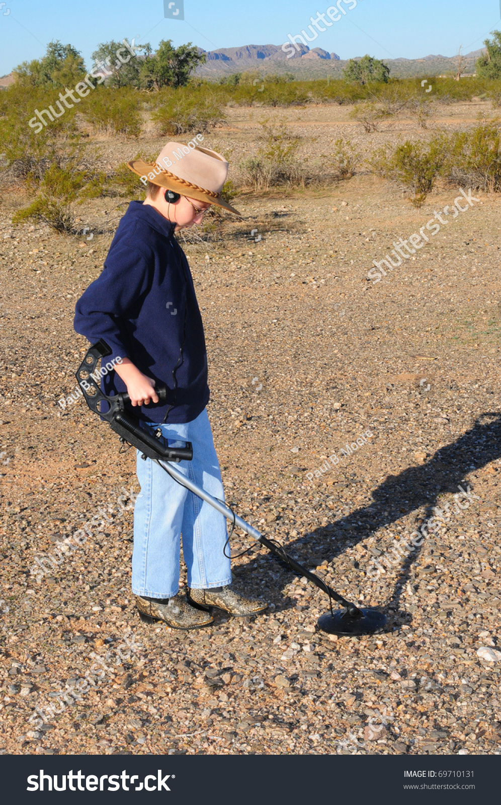 Jew Detector: Young Boy Hunting Treasure Metal Detector Stock Photo