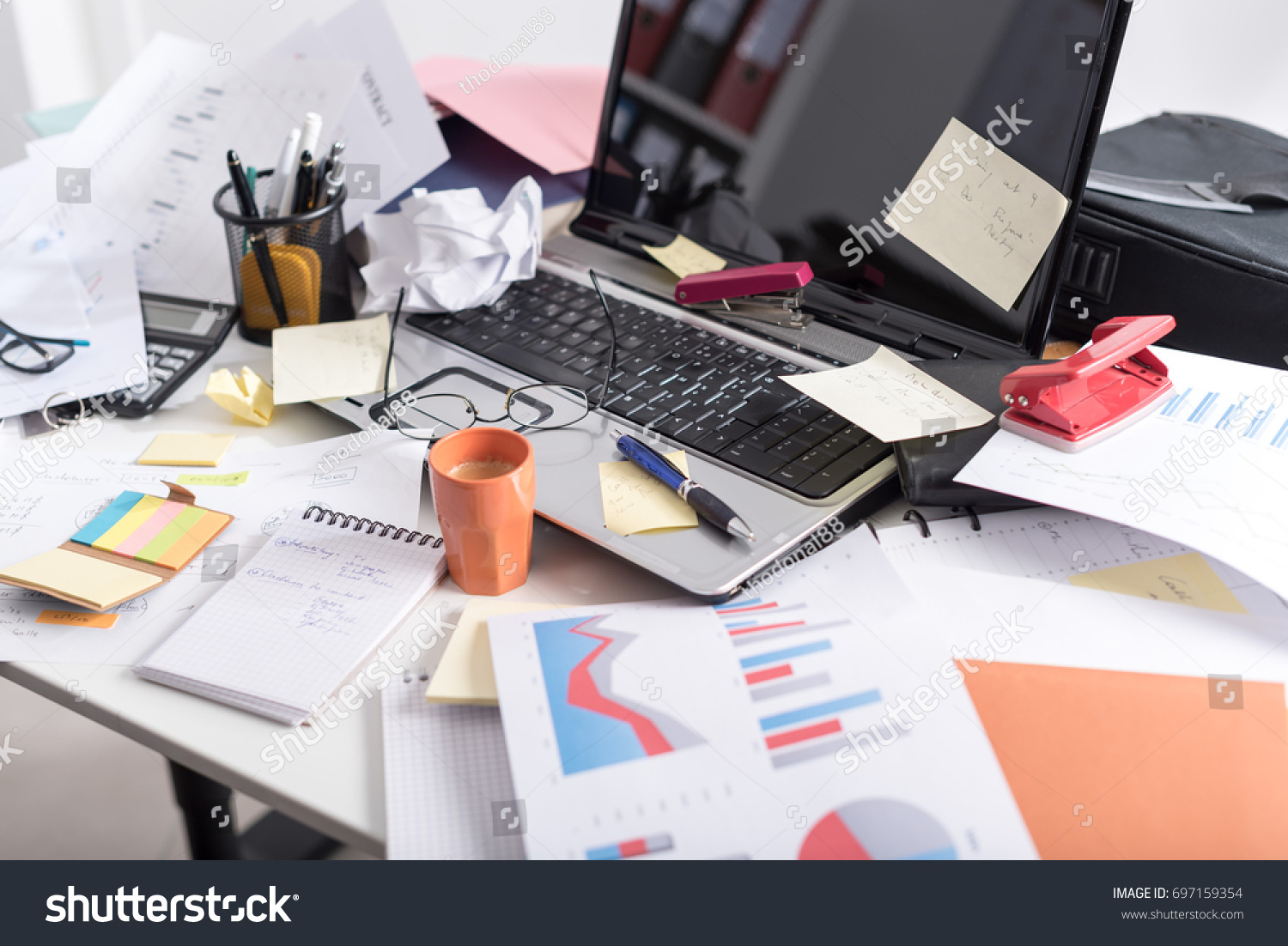 Messy and cluttered office desk #697159354