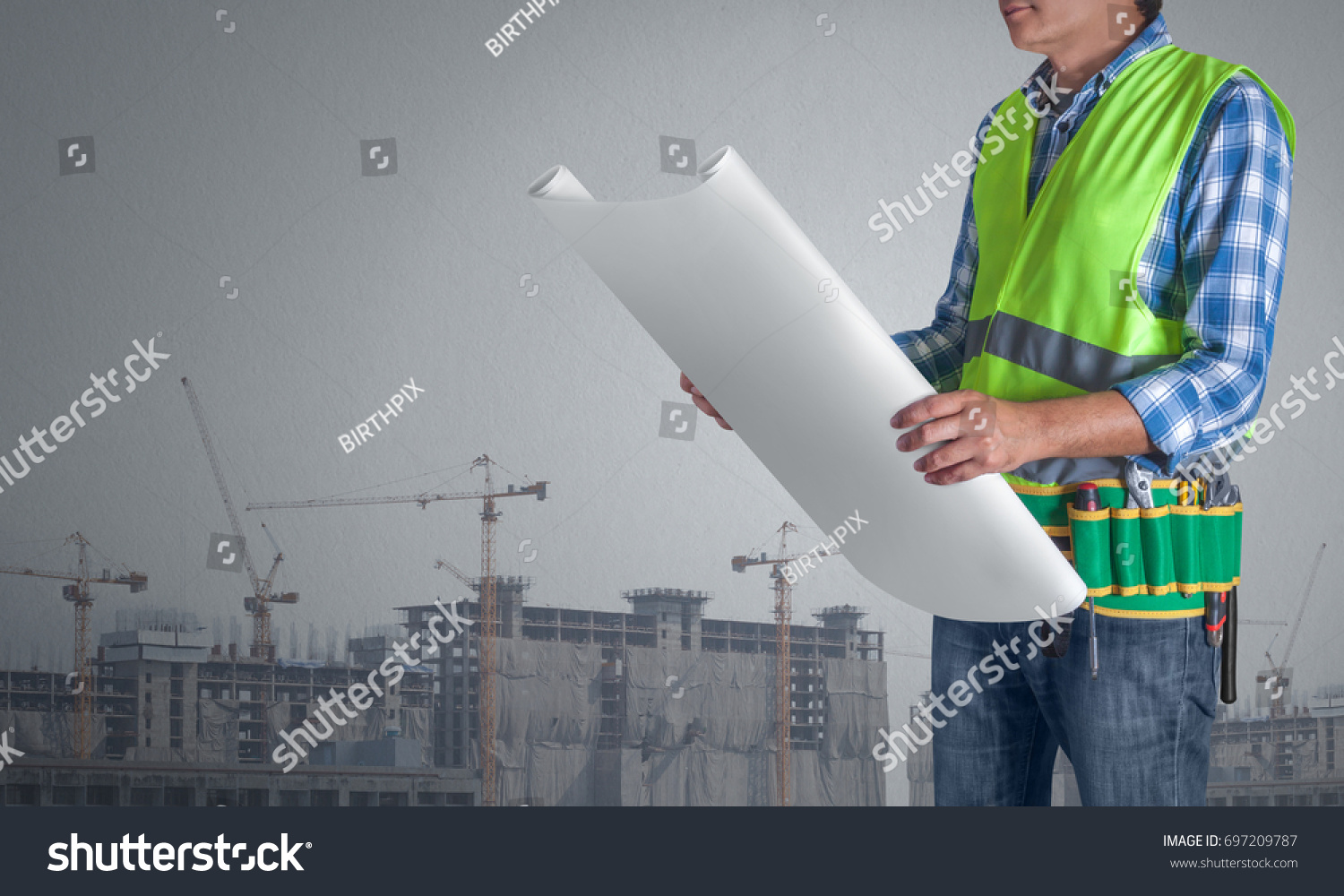 Worker man all tools supplies holding stock photo 697209787 a worker man with all of tools supplies holding construction plan blueprint ready for check and malvernweather Choice Image