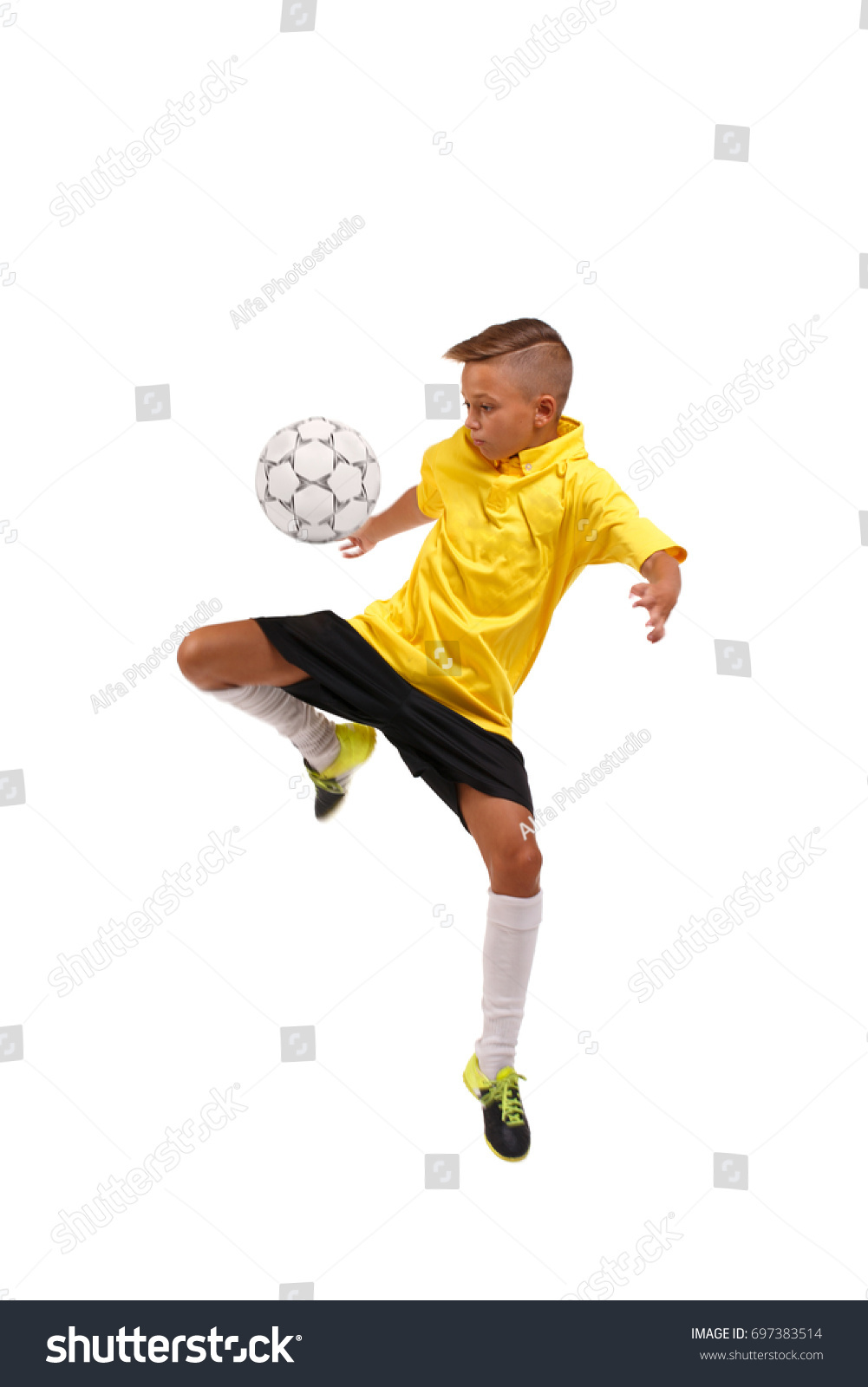 58fa00b61 A sportive boy kicking a soccer ball. A little kid in a football uniform  isolated on a white background. Sports concept. - Image