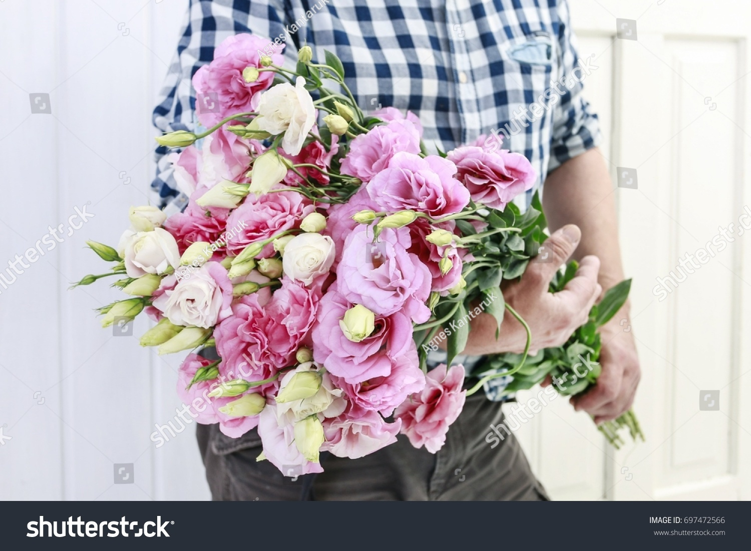 Florist Carrying A Big Bunch Of Pink Eustoma Flowers Gardener At