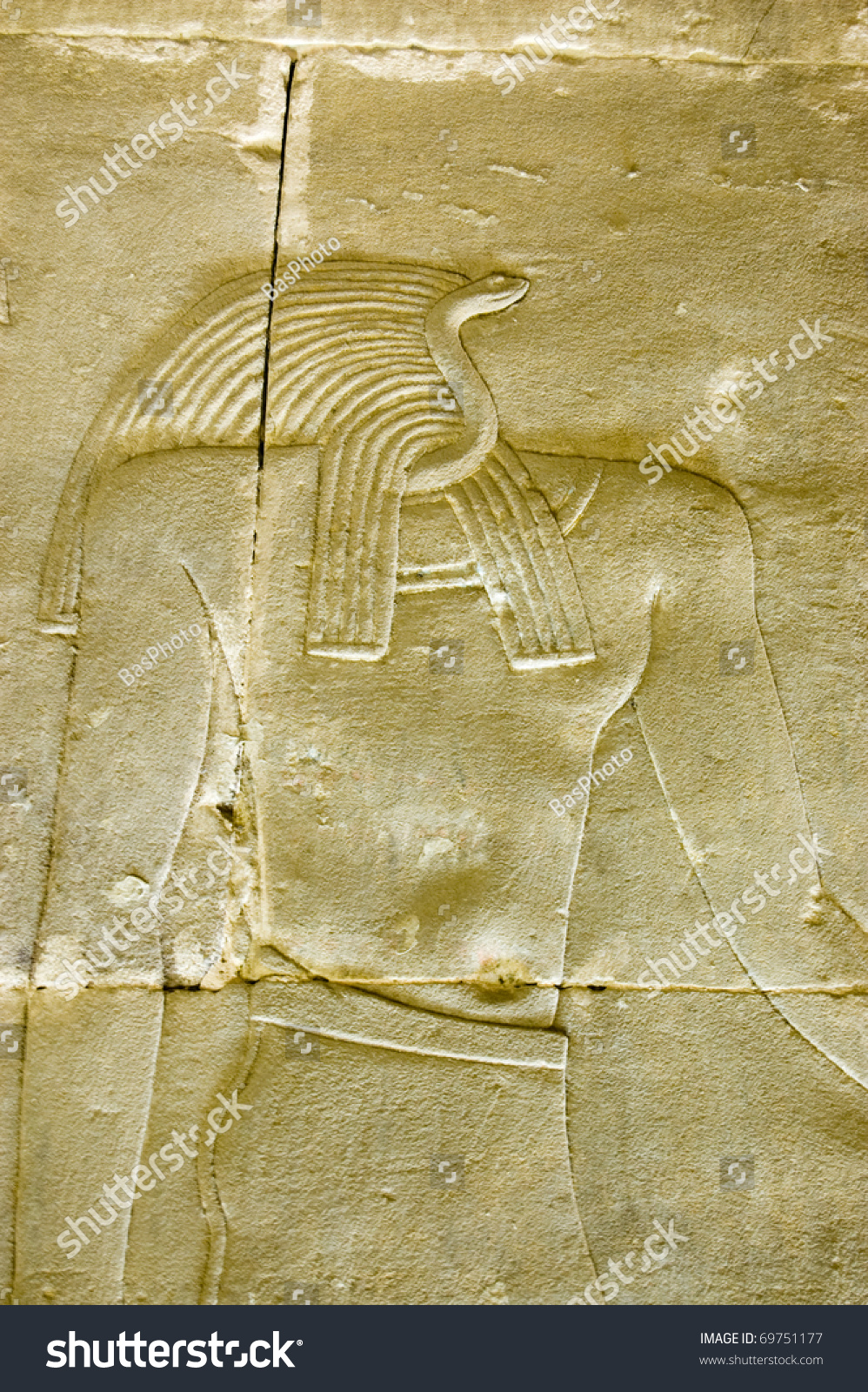 ancient egyptian stone carving of the snake headed god