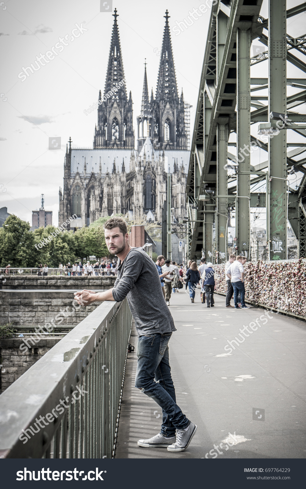 young man cologne with bridge and koln dom evening scene over cologne koln city