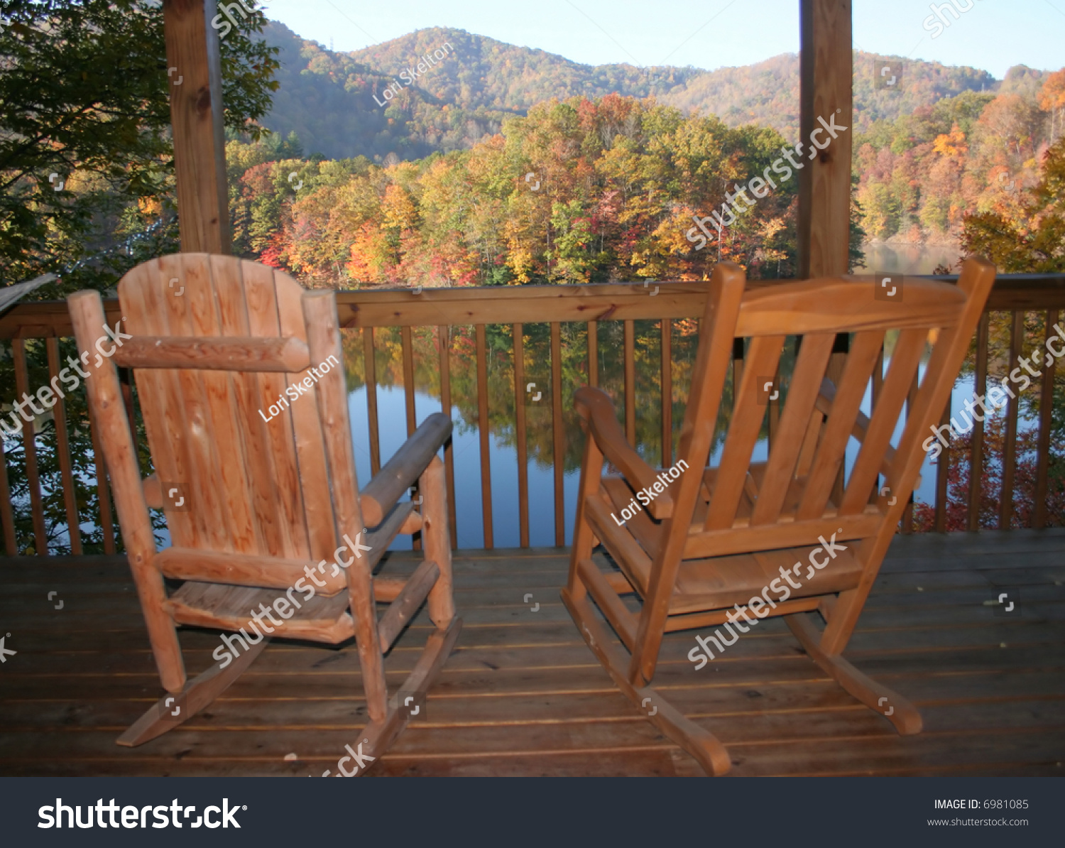 Rocking Chairs On Porch Overlooking Lake Stock Photo