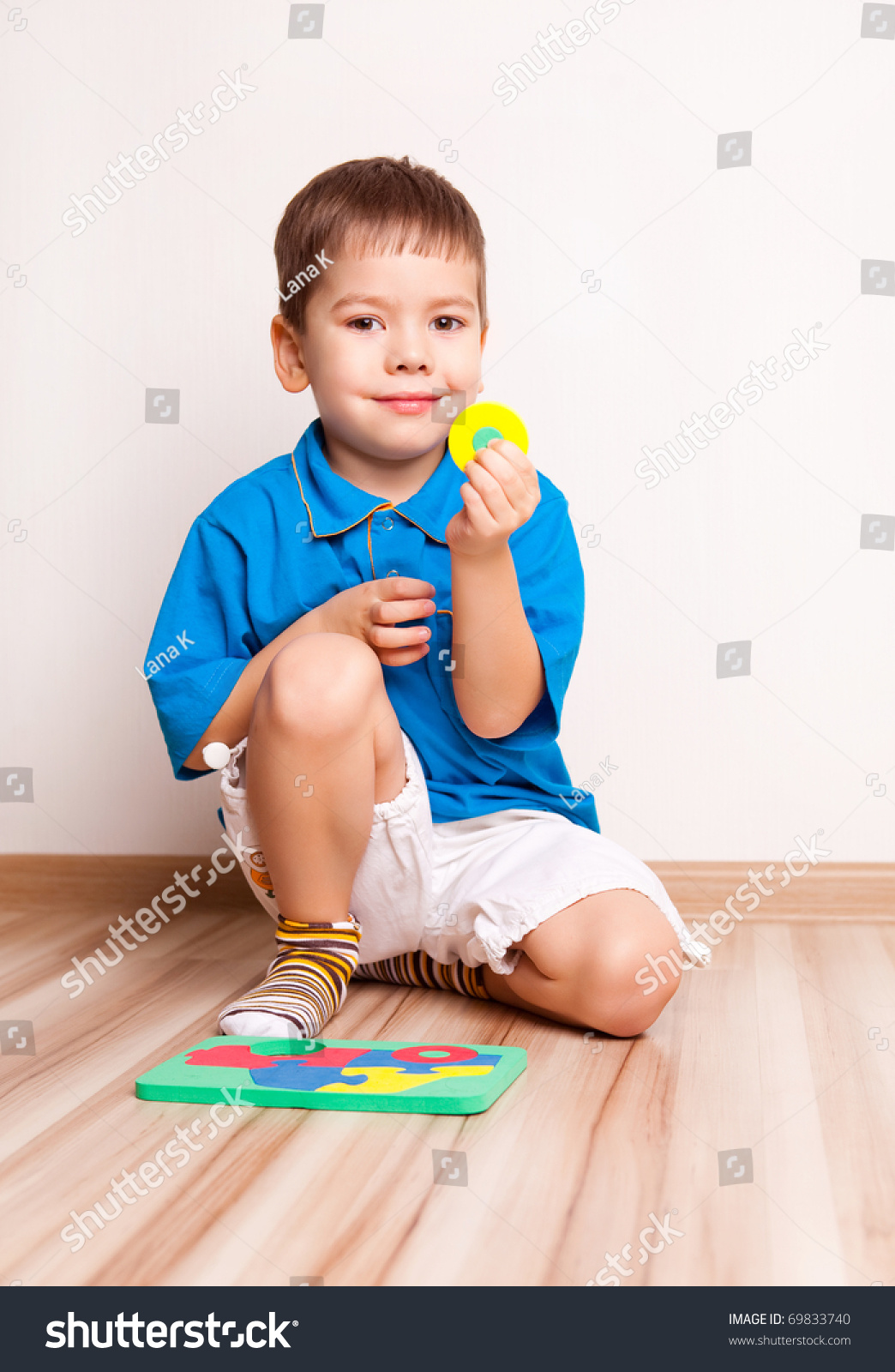 Adorable Four Year Boy With Big Blue Eyes Stock Image: Cute Four Year Old Boy Playing With Toys On The Floor At