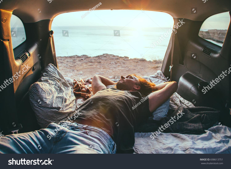 Man Relaxing Sleeping Inside Car Trunk Stock Photo 698613751