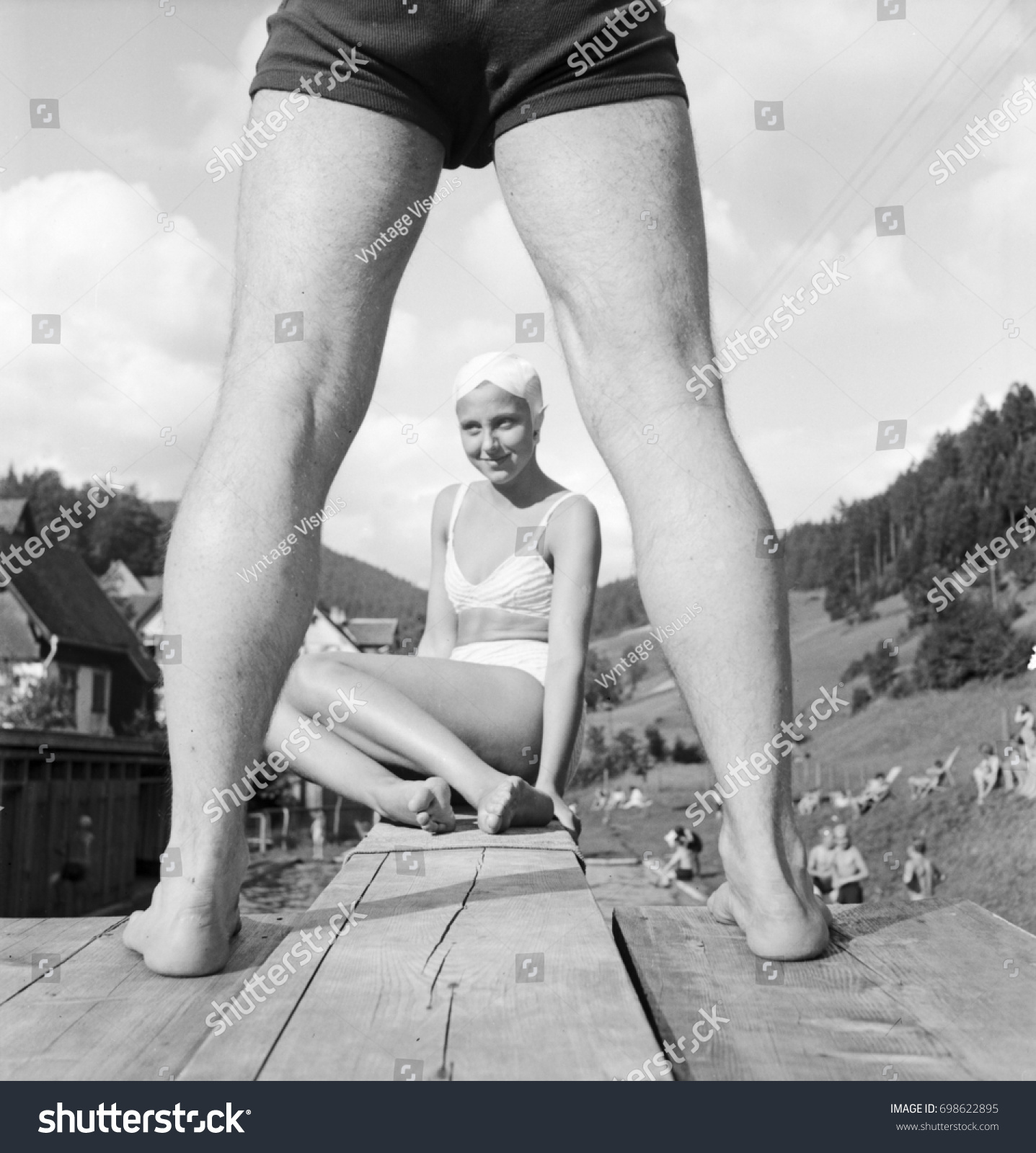 young woman wearing swimming costume sitting stock photo (royalty