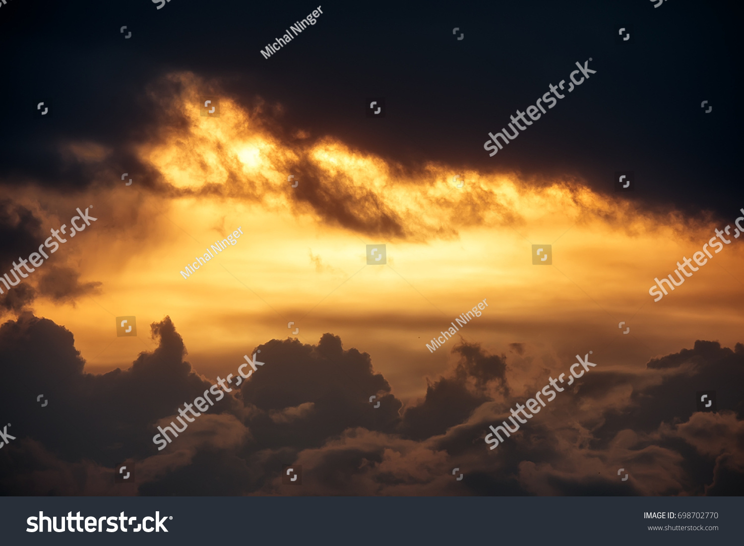 Very dramatic clouds scene with sunset on the sky