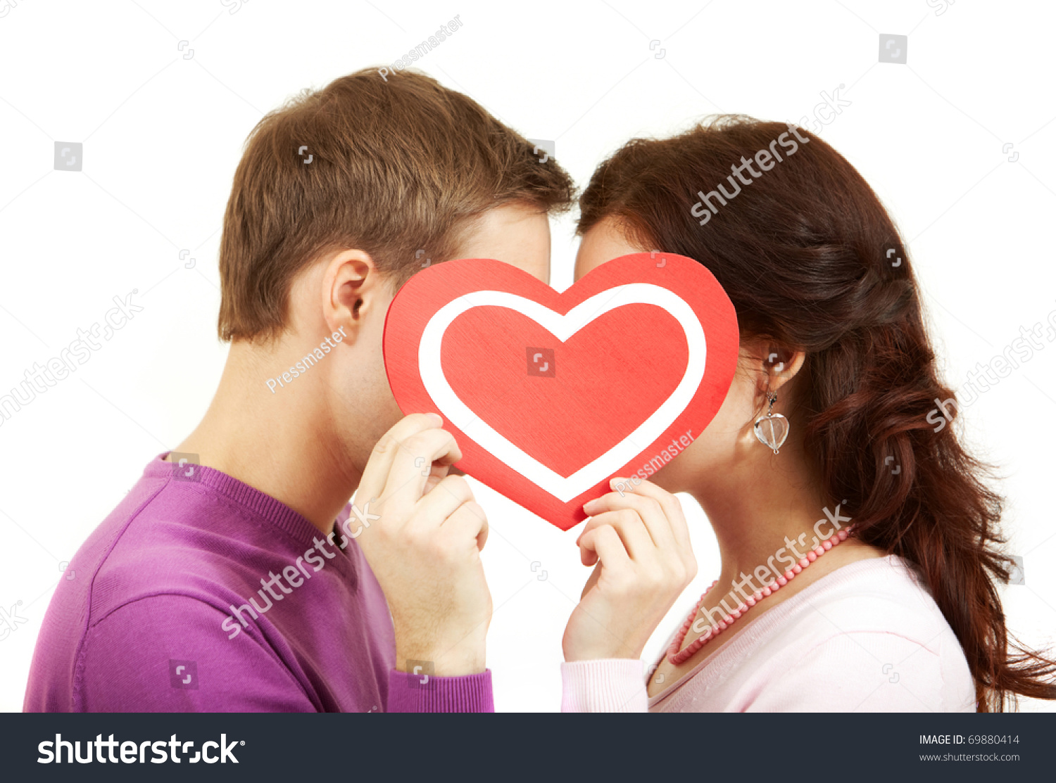 Two Young People Kissing Behind A Paper Heart Stock Photo ...