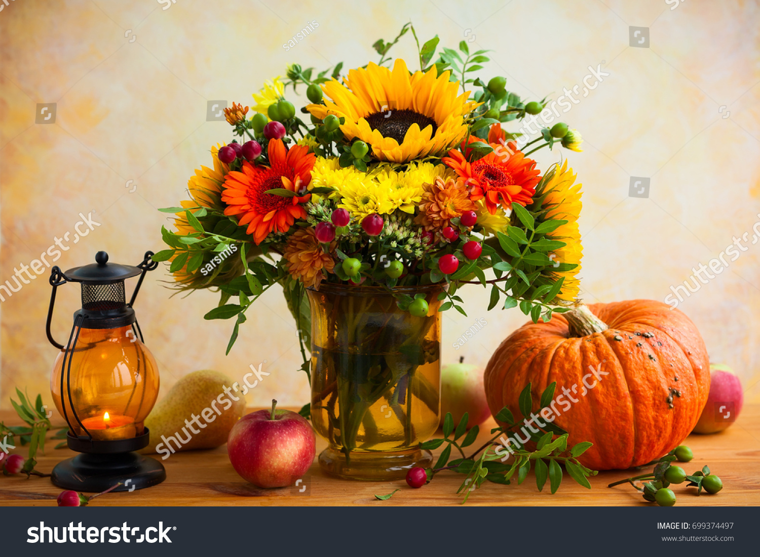 Autumn still life with flowers, pumpkin and fruits #699374497