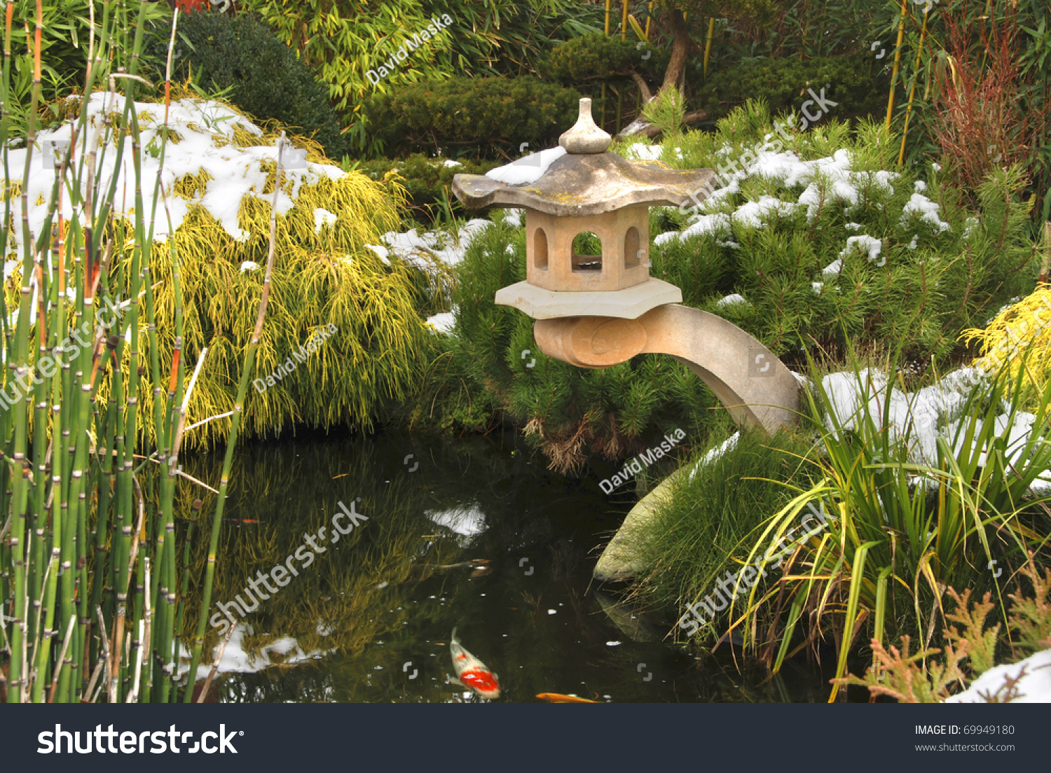 decorative japanese garden with a koi pond and lanthern