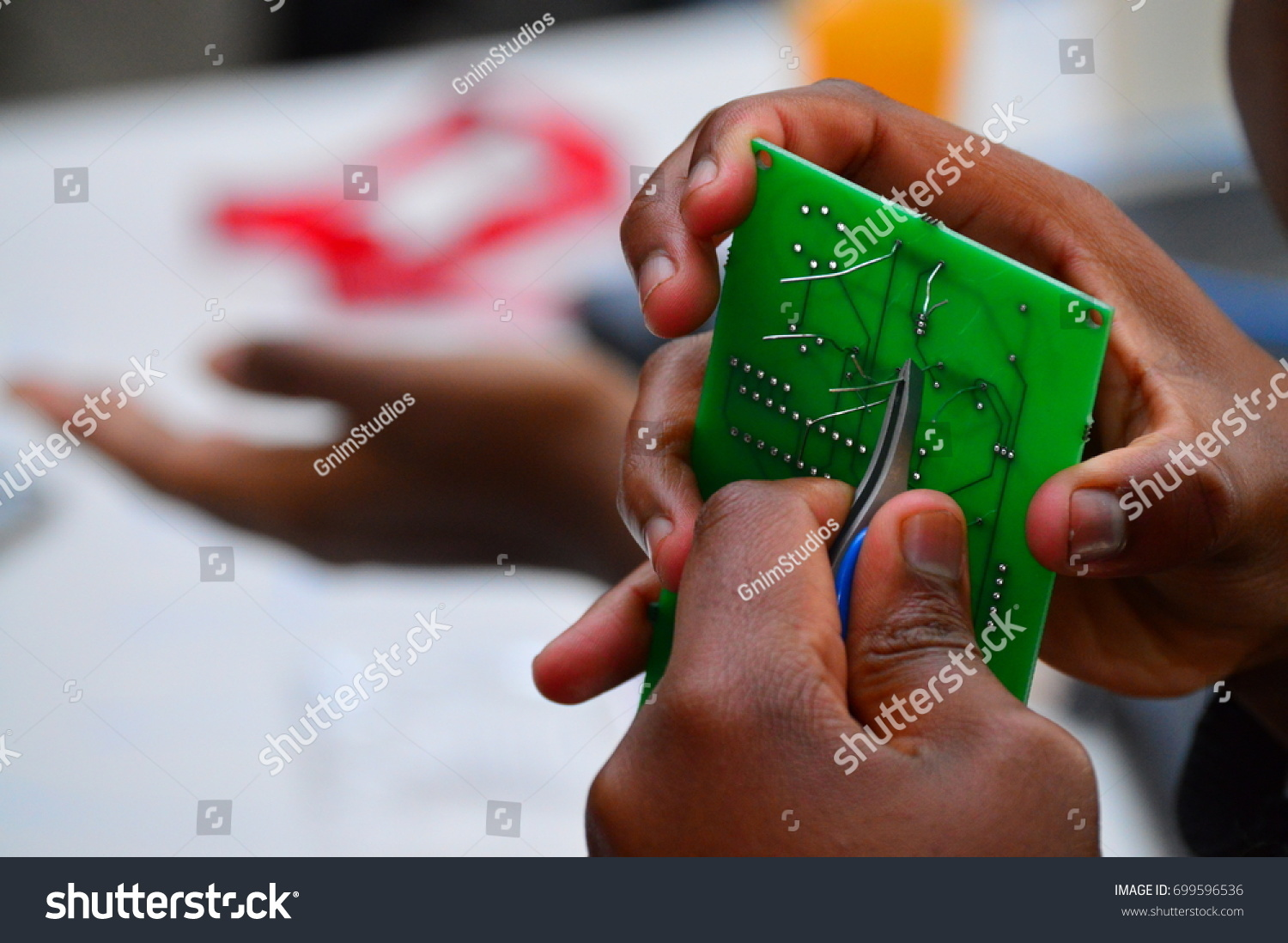 Hand Holding Printed Circuit Board Pcb Stock Photo Edit Now Cutter Images Of The Using Cut Pliers To Clip Off