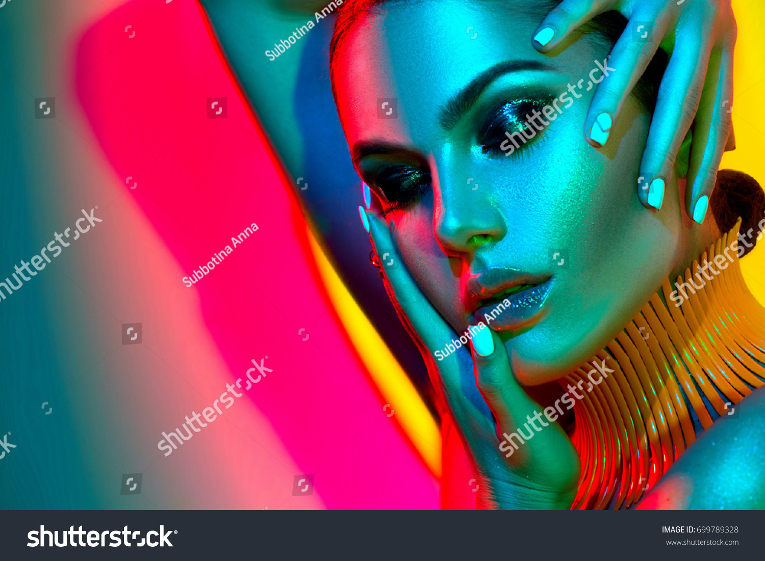 High Fashion model woman in colorful bright lights posing in studio, portrait of beautiful sexy girl with trendy make-up and manicure. Art design, colorful make up. Over colourful vivid background. #699789328 - 123PhotoFree.com