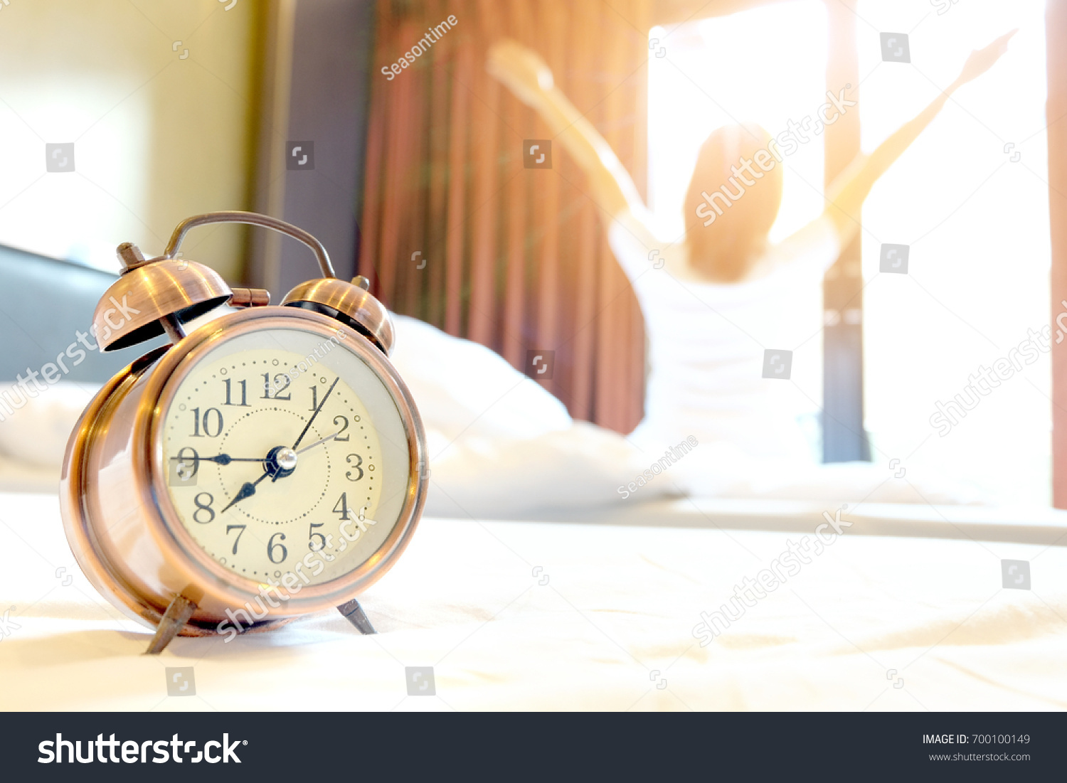 Morning Of A New Day Alarm Clock Wake Up Woman In The Room A