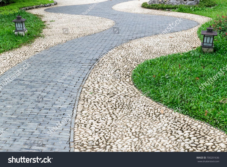 Stone brick walkway pavement garden pass stock photo for Garage door repair round lake il