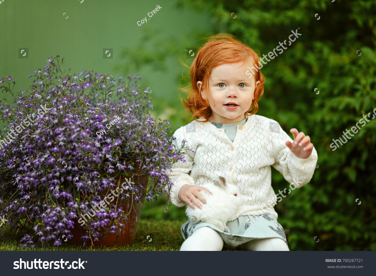 little beautiful redhaired girl baby girl stock photo (royalty free