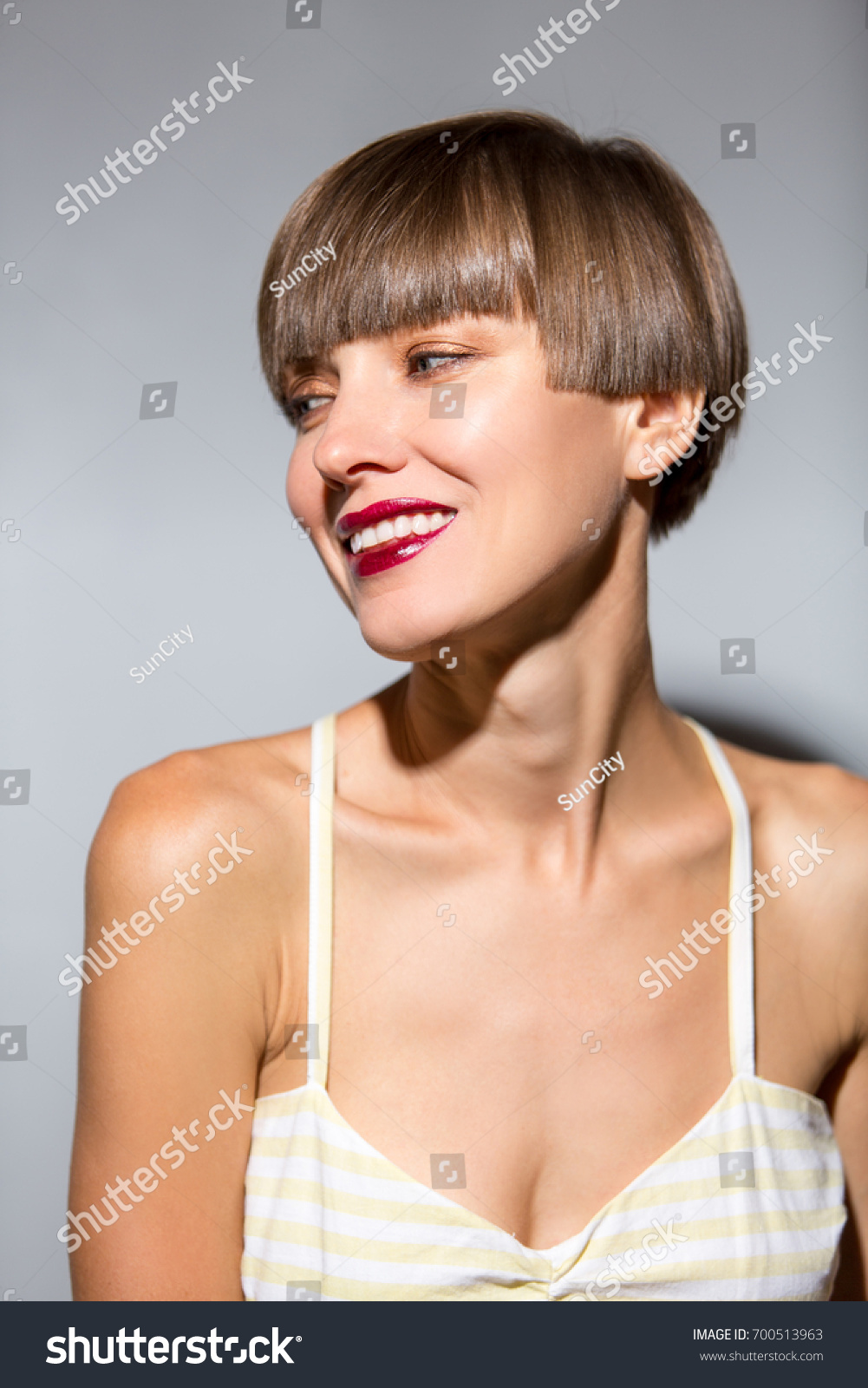 9379e271ad8 Smiling beautiful woman with brown short hair. Haircut. Hairstyle. Fringe.  Professional makeup