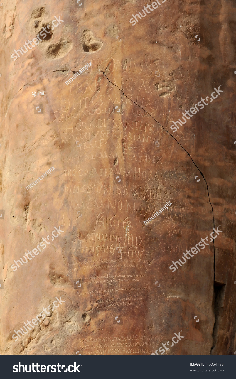 Ancient greek and ancient roman graffiti on the even more ancient colossus of memnon at thebes
