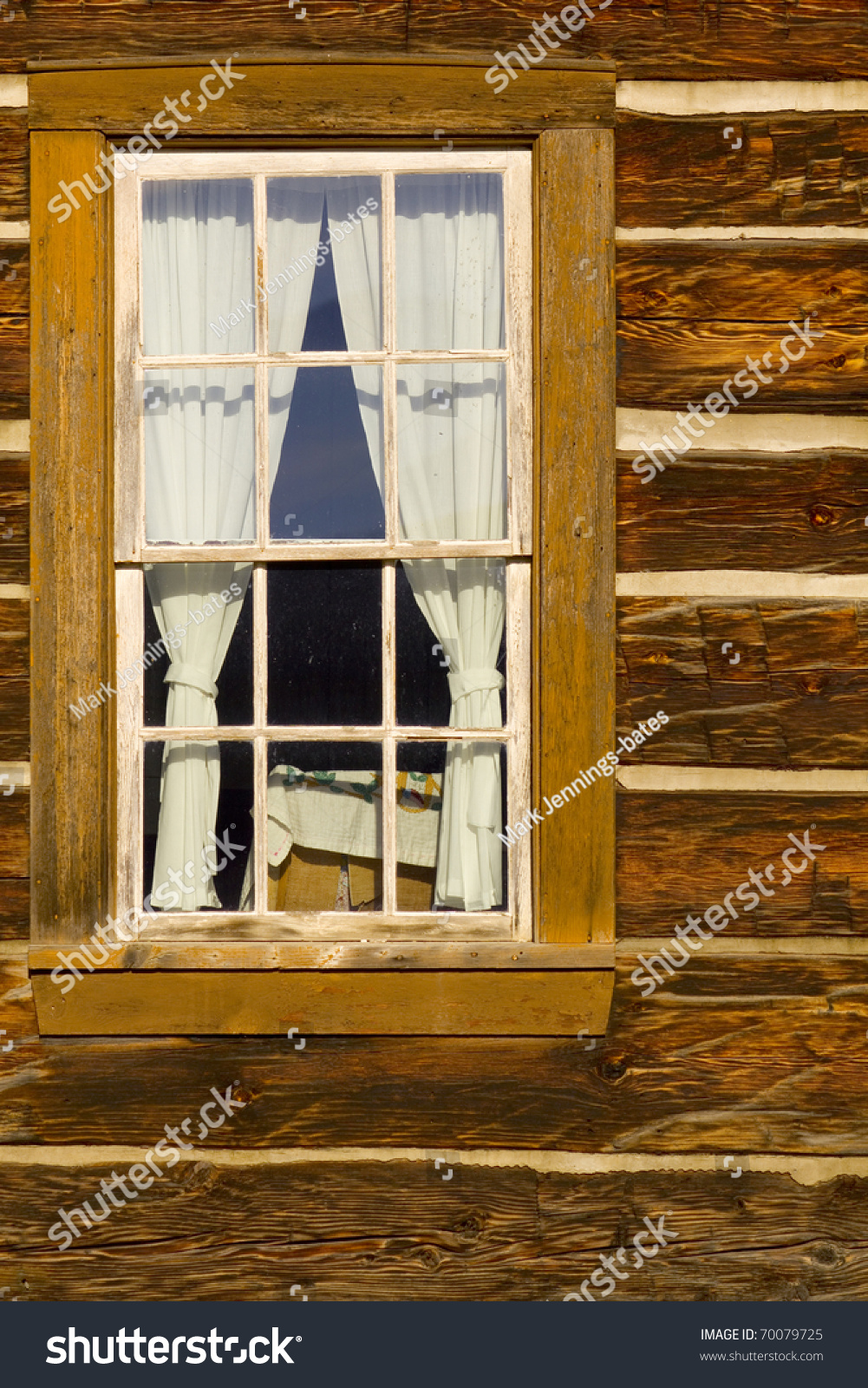 exceptional log cabin window #3: Portrait of old log cabin window with square log detail and chinking