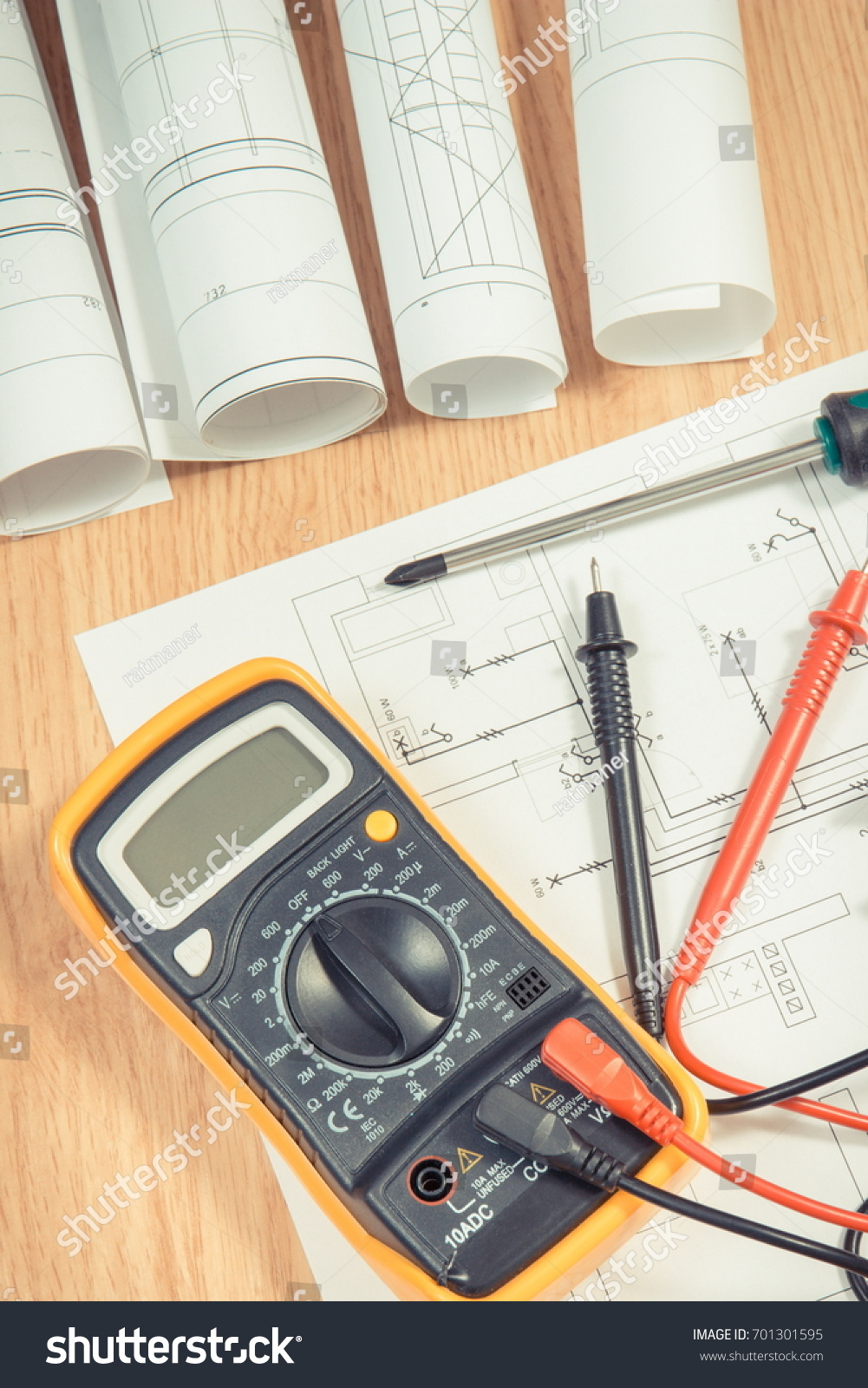 Electrical construction blueprint drawings diagrams multimeter electrical construction blueprint drawings diagrams multimeter stock photo 701301595 shutterstock malvernweather Gallery
