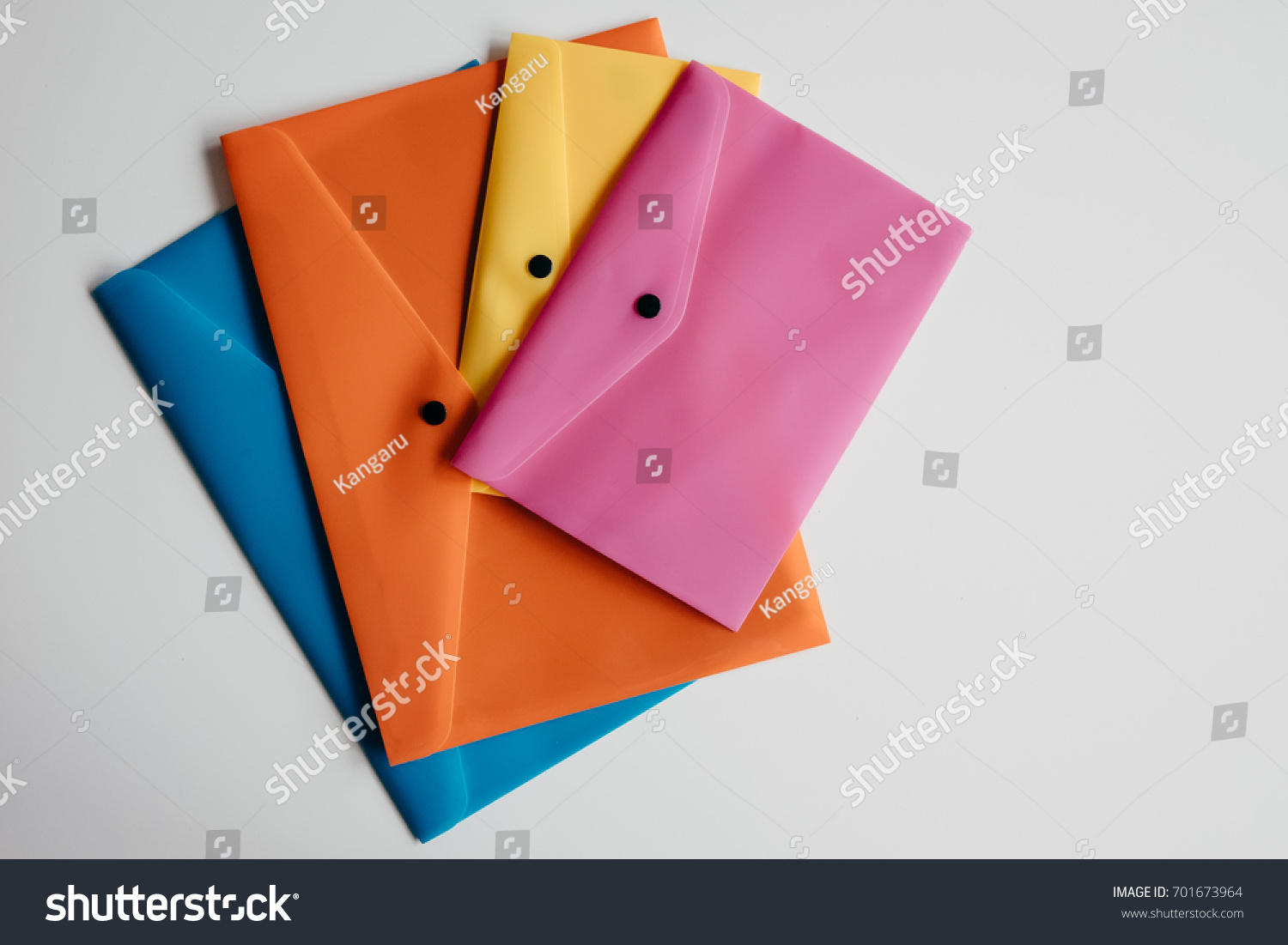 Composition Four Plastic Envelopes Different Colors Stock Photo ...