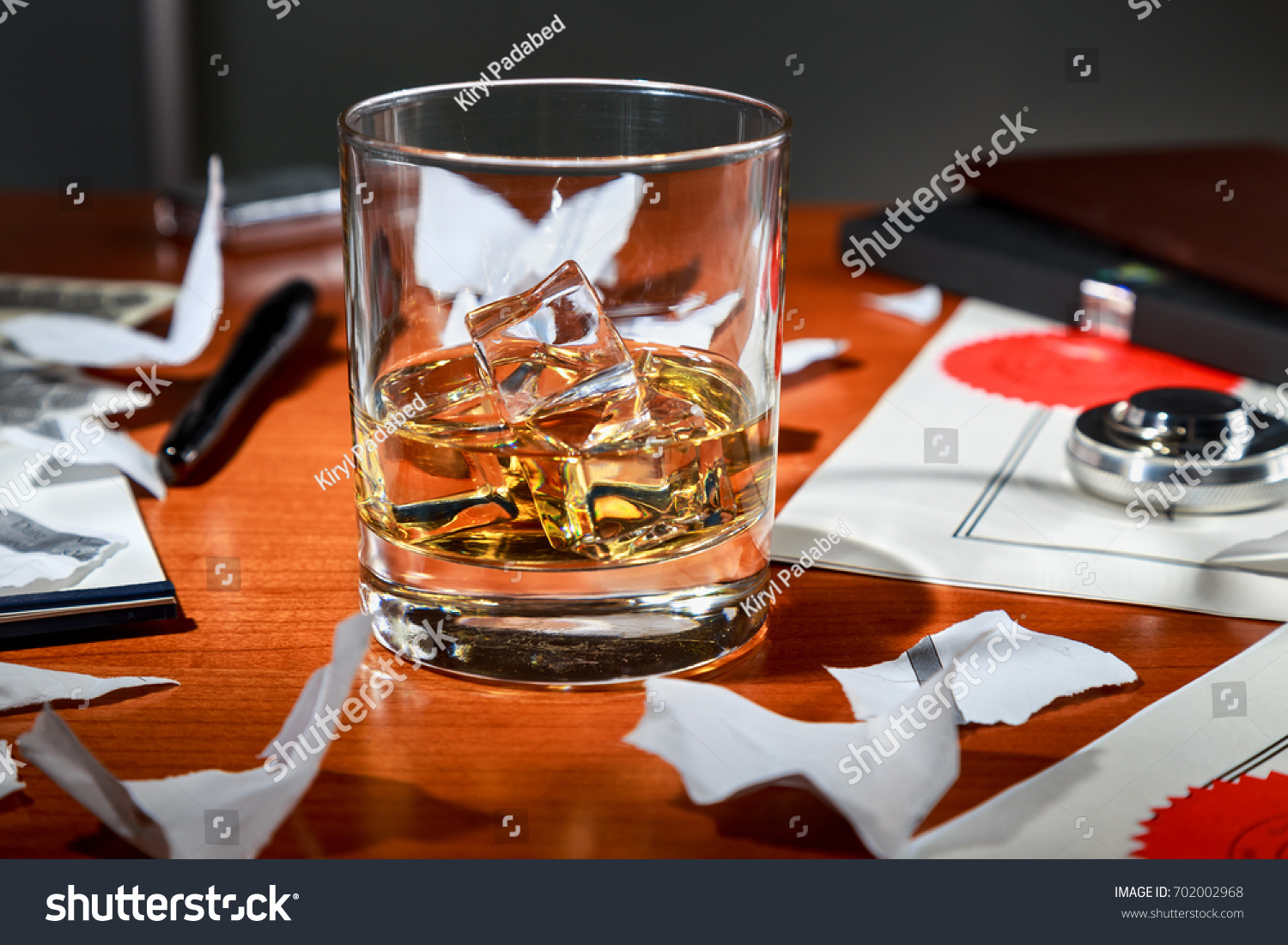 expensive office desk curved whiskey with ice on an expensive office desk the background of torn contract whiskey ice on expensive office stock photo edit now