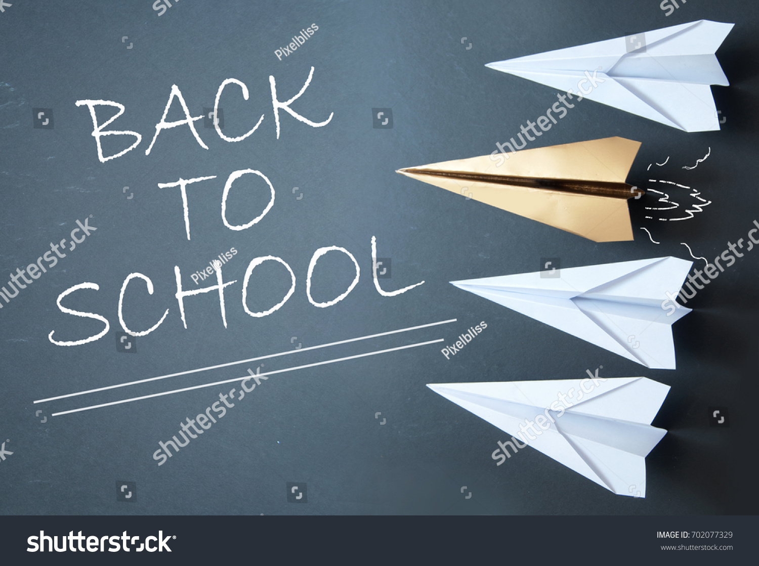Back school handwritten on chalkboard gold stock photo 702077329 back to school handwritten on chalkboard with gold paper plane standing out in a line of jeuxipadfo Image collections