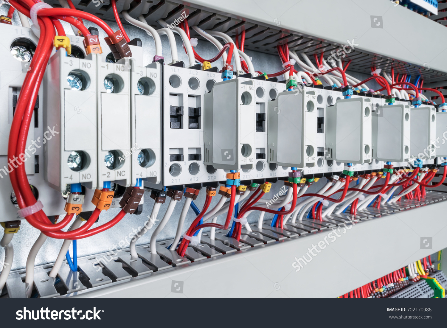 Several Contactors Arranged In A Row In An Electrical Closet. The  Contactors Connected Wire Number