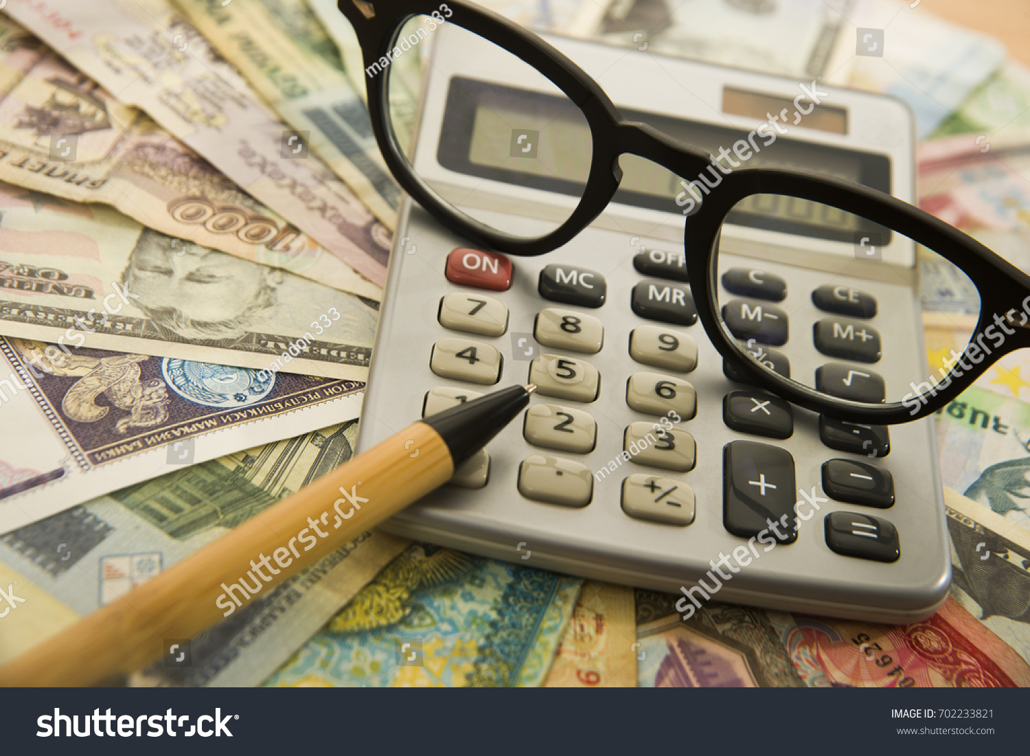 Calculating numbers income tax return glasses stock photo (edit.