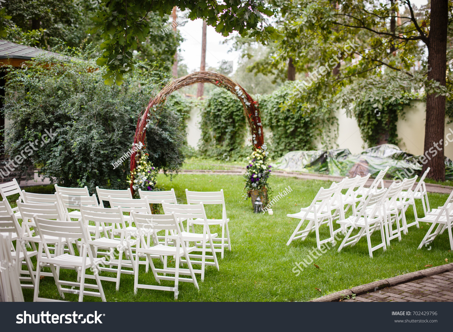 Wedding set garden wedding ceremony wedding stock photo edit now wedding set up in a garden wedding ceremony wedding decorationswedding archway with junglespirit Image collections