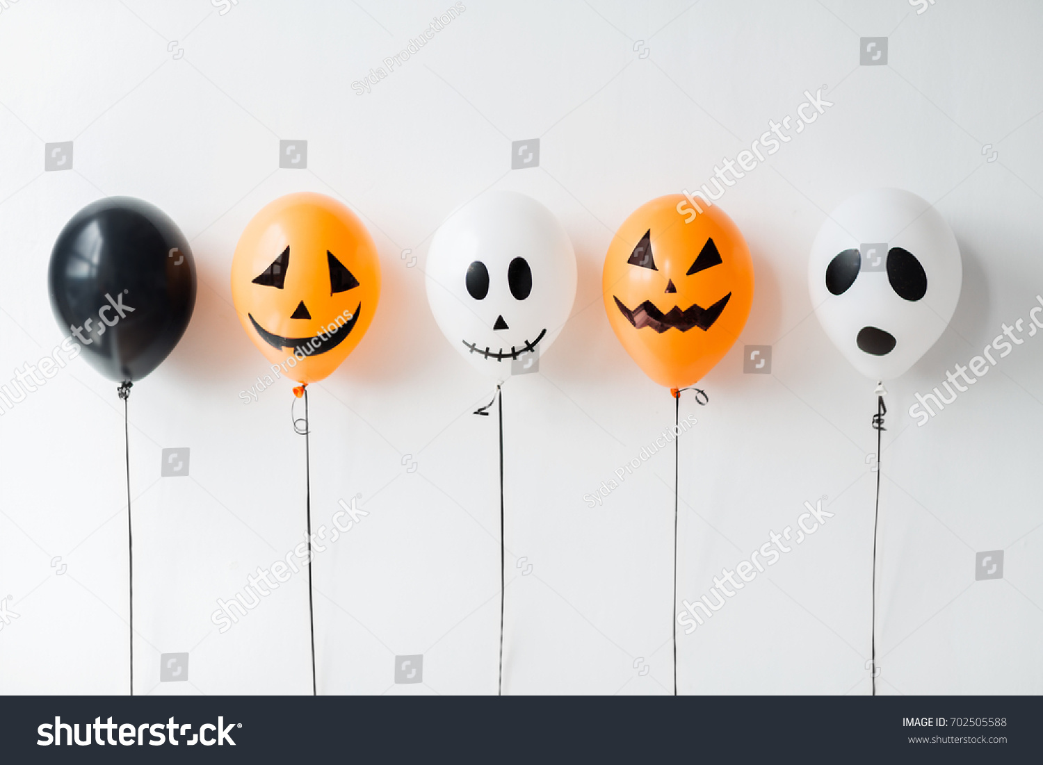 holidays, decoration and party concept - scary air balloons for halloween over white background #702505588