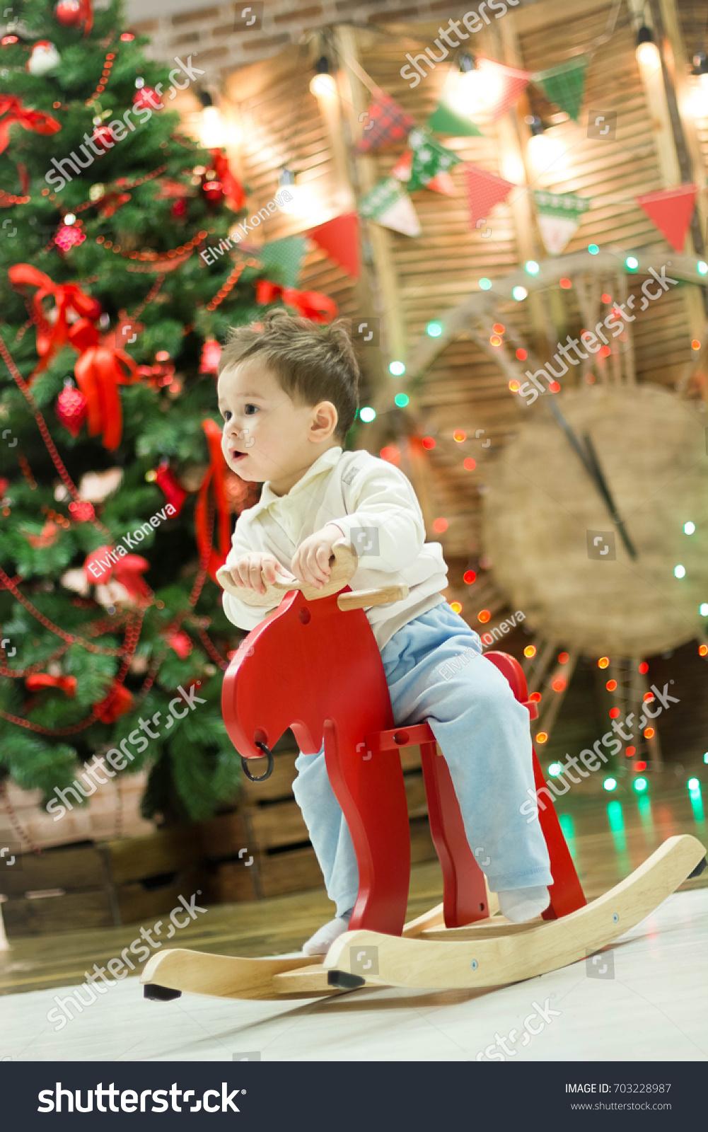 happy cute small boy riding wooden stock photo 703228987