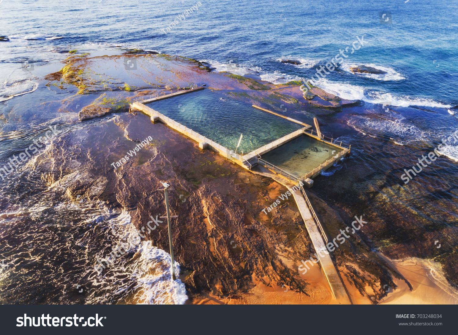 Remote isolated rock pool off mona stock photo 703248034 remote isolated rock pool off mona vale beach at high tide with swimmer breaking waves of nvjuhfo Gallery