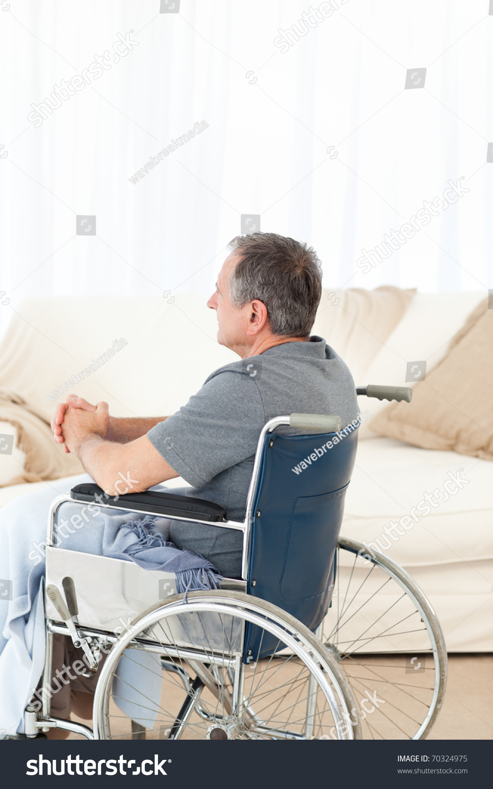 Retired man his wheelchair home stock photo 70324975 for Wheelchair home