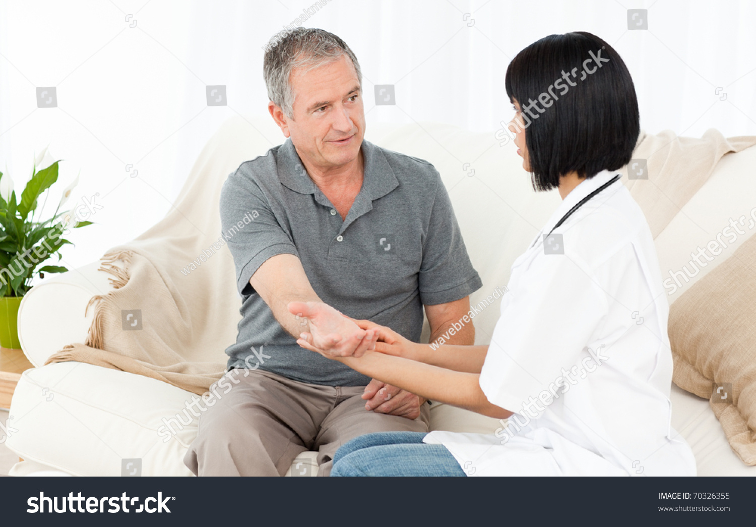 Nurse Taking Pulse Her Patient Stock Photo 70326355 ...