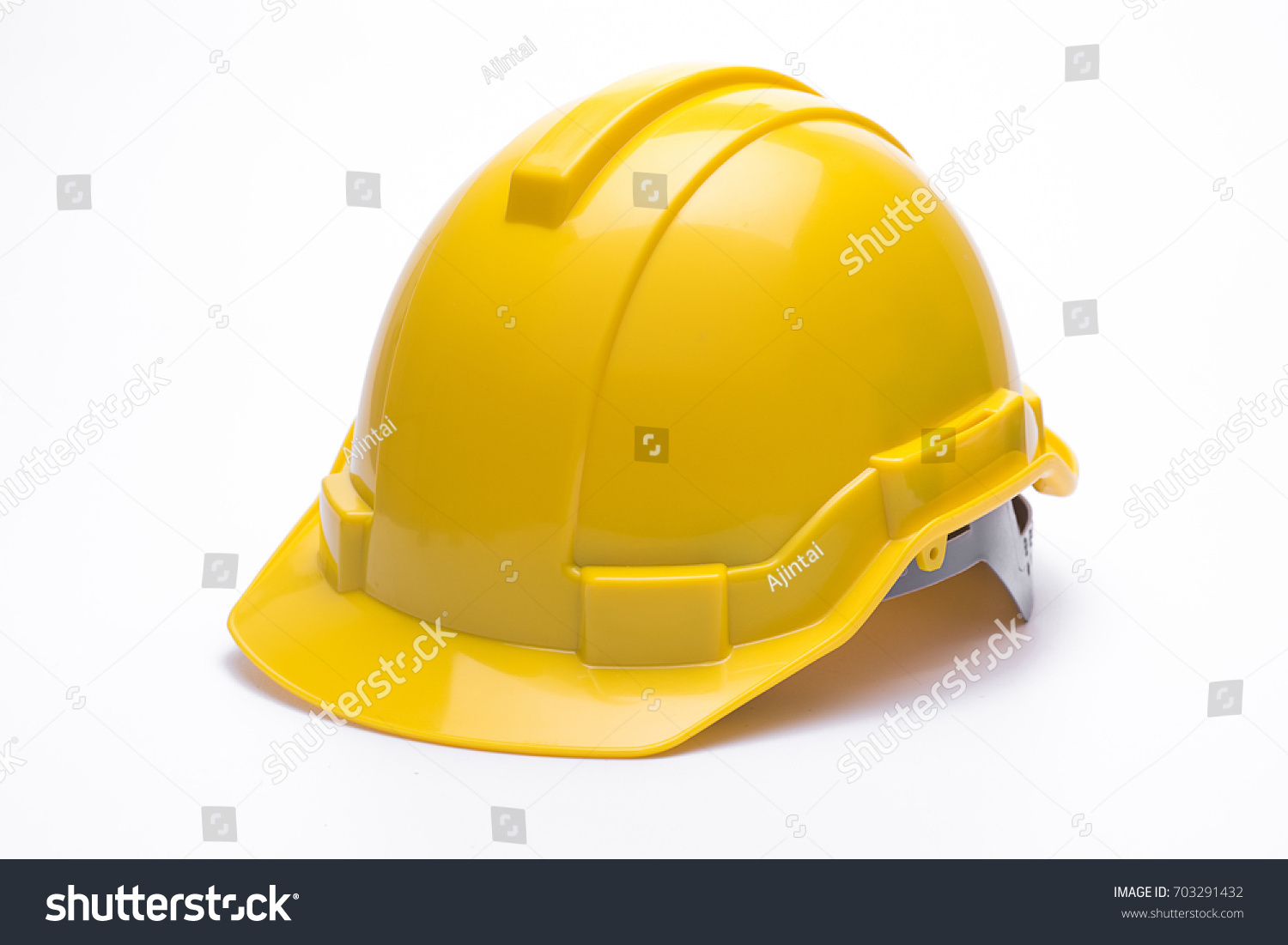 Yellow safety helmet isolated on white background #703291432