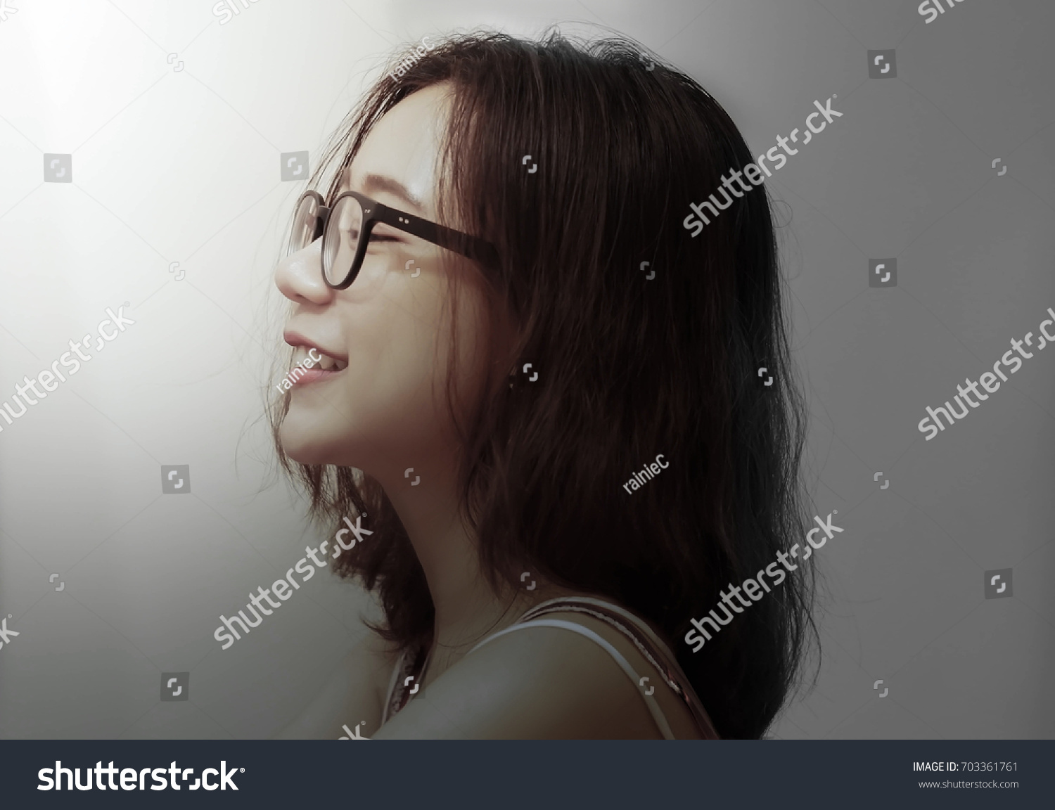 ffa2a4d4bd29 Beautiful Portrait of Asian Woman s face with glasses in side view with  emotions of happy