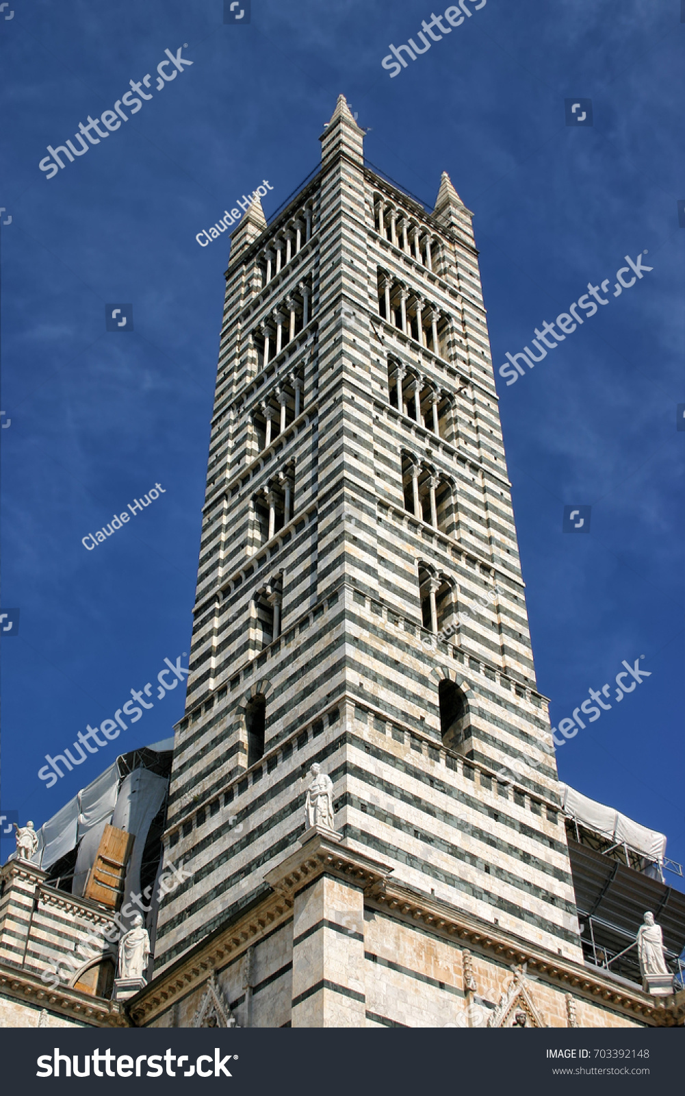 Bell tower of the Siena Cathedral which is a medieval church dedicated to the Assumption of the Virgin Mary.